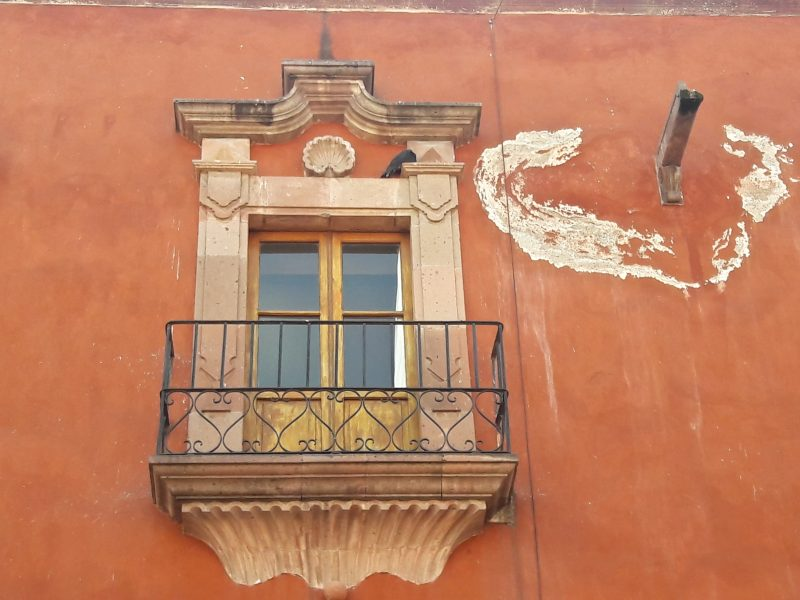 Ornate window balcony waste pipe UNESCO World Heritage site San Miguel de Allende Mexico live like local